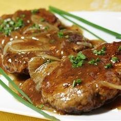 "Hamburger Steak with Onions and Gravy | ""We loved this recipe, thanks! I used French Onion soup instead of the beef broth, and would highly recommend using ground Angus for the beef. """