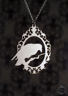 Stainless Raven silhouette cameo necklace  by FableAndFury on Etsy, $29.00