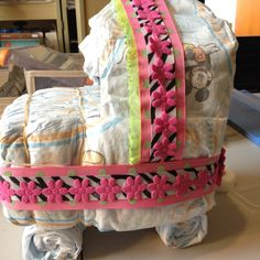 Made a baby carriage out of diapers!