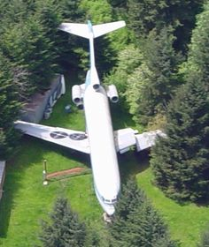 Convert a plane into a home, then place it in the middle of the woods. Sounds good to me. :)