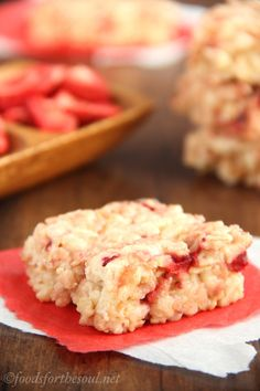 Skinny Strawberry Cheesecake Rice Krispie Treats -- soft, chewy & SO addictive. You only need 5 ingredients to make them!