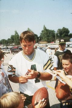 Brett Farve Signing Autographs by Wisconsin Historical Images, via Flickr