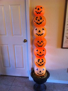 Drill hole and stack pumpkin pails.  Pull string lights through