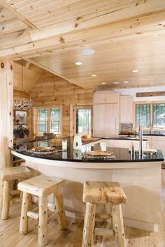 Log Home Kitchen - love the whole kitchen, but check out that awesome antler light fixture in the back ground!! This would be a great bat to!!