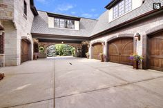 Motor Court, accessible through porte-Cochere, and 6-car Garage with wood carriage doors...