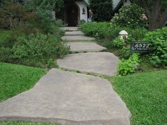 The stepping stones leading to the front door are made of concrete with a stamped pattern on top to give a flagstone look.