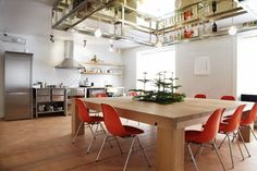 kitchen with red / orange chairs