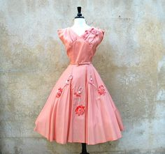Stunning tea length salmon colored satin party dress from the 50's.