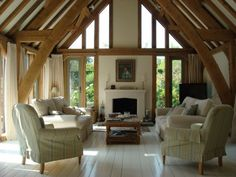 English sitting room with oak beams and painted floorboards