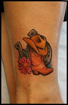 Cowgirl tattoo 2012 Cowboy boots, pink daisy, cowgirl hat, horseshoe to represent children. Stars to represent grandchildren. Ankle tattoo...