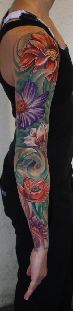 Ty McEwen - color flower tattoo sleeve