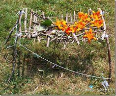 """Miniature tree house using sticks, flowers, leaves & yarn ("""",)"""