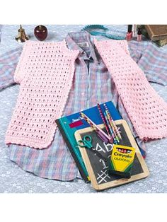 Girl's Pink and Pretty Vest Younger girls will look pretty in pink at school in this sweet vest. Designed by Shirley Souch free pdf