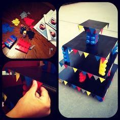 Cupcake stand!! ... Cardboard, mega blocks, card stock paper, and a glue gun.