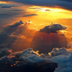 Sun streaming through the clouds
