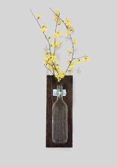 Wall Mounted Wine Bottle Vase - this would actually be an easy DIY