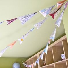 Create your own paper airplane bunting with recycled old maps and bits of extra scrapbook paper.