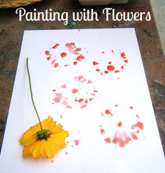 Let the children play: Painting with flowers. A great activity for kids in any weather.
