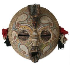 """Zaire """"Flying Protector"""" Mask, by Salihu Ibrahim. These kinds of masks, of Pande and Kasai tribal origin, are believed to protect from all flying evils. This version includes recycled glass beads and cotton pompom trim."""