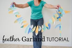 DIY Feather Garland Tutorial - this would add an eclectic touch to any nursery or kids room!