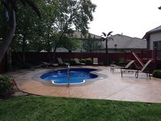 Concrete Pool Decks Decorative concrete allows swimming pool decks to complement the exterior of the home.  Decorative concrete swimming pool decks are a popular trend.  Colored concrete can providing a colored, textured and inviting area surrounding the pool deck.