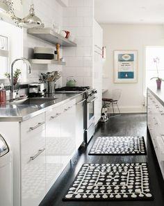 Dark floors in a white kitchen