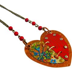 Reclaimed Tin Mixed Media Necklace A Lovely heart necklace fashioned entirely by hand from vintage reclaimed tin; cut from a pattern, riveted together on a copper base, and then given a special patina for a rustic aged appearance. The necklace measures 24 inches with a bronze chain with red beads.