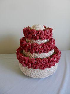 Raymond Hudd hat of roses on cake