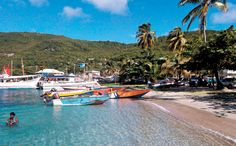 Luxury and niche cruise ships drop anchor in Admiralty Bay, just offshore from Port Elizabeth, Bequia's main village.