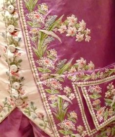 Detail of waistcoat, frock coat embroidery of a gentleman's suit, 1770-1780, France. purple silk satin embroidered with polychrome silk yarns in chain stitch in floral motif at front line, vents, collar, cuffs pockets and flaps, buttons; stand-up collar, round cuffs with three buttons, padded upper chest, white silk satin lining.