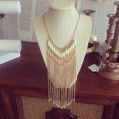 Gold necklace with small peach beads and ivory cylinder beads.     14.5 inches from top to bottom