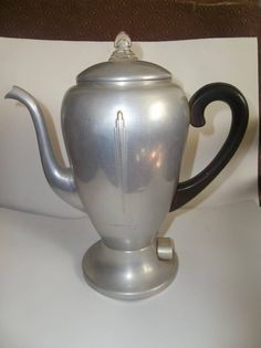 I love using these vintage coffee pots to put plants in, but this way cool one might just need to stay a coffee pot.