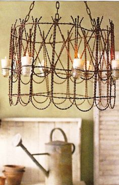 Porch Chandelier:  Take a couple of those tacky little garden wire fence pieces, wire them together forming your circle, flip it upside down & attach some rope or rusty chain, then take a few glass insulators and attach them to the outside with some more rusty wire...& you have yourself a pretty cool hanging light:)