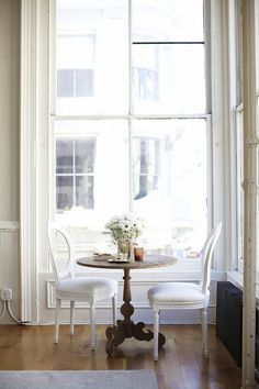 A beautiful table setting, tall ceilings, large windows, shades of white :)