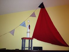 DIY sail & nautical setup on entertainment unit for shower. Red cloth thumb tacked to ceiling. Couple pennants, and a pelican statue. Super easy! Just used staples to fasten together.