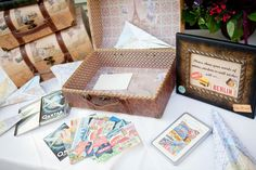 use suitcase for thank you envelopes, advice, well wishes