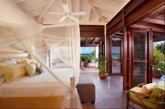 tropical bedroom by MCM Architects