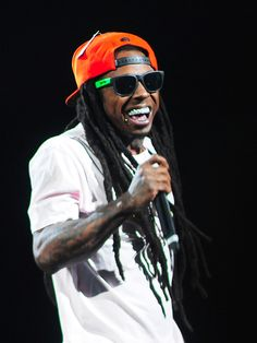 """Rapper Lil Wayne performs his """"America's Most Wanted"""" tour concert to a capacity crowd at the MGM Grand Garden Arena in Las Vegas, Nevada on  August 31, 2013.  Photo credit: Steve Spatafore/Las Vegas News Bureau"""