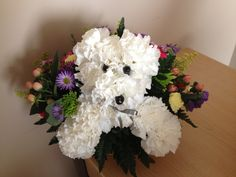 "Get well ""puppy flowers"".  So cute!"