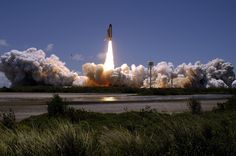 July 4, 2006. 2:38 p.m. EDT. Launch of Space Shuttle Discovery on STS-121 mission to the International Space Station. The launch was scrubbed twice, July 1 and 2, due to weather concerns. Launching on July 4, it made history as the first launch on Independence Day. Image credit: Nikon/Scott Andrews. Source: NASA