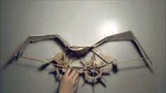 Kinetic winged sculpture made from popsicle sticks by Joyce Lin