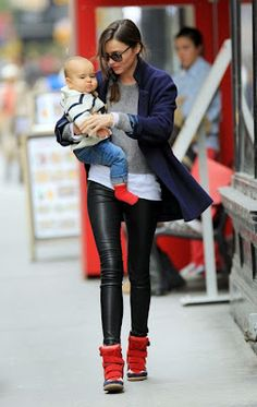We're going bananas for Miranda Kerr in Isabel Marant sneakers! Check out how to get these sneakers for less: http://rewards4mom.com/would-you-try-this-trend-hi-top-wedge-sneakers/