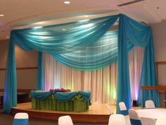 Stage canopy and cake table draping for a sweet sixteen party.