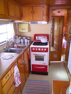 Very Sharp Retro Kitchen and Oven in 1950 Spartanette Tandem RV.  Totally adaptable to Tiny Home living.