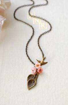 There are lilies And a bird necklace.