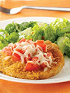 Bruschetta Pork Chops — It only takes half an hour to make these flavorful pork chops with a crunchy coating and bruschetta-inspired topping.