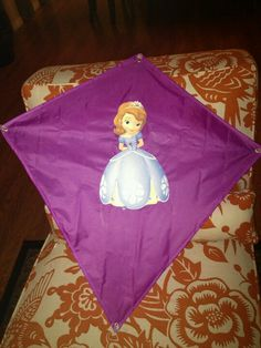 Dollar store kite with Sofia image glued on. I'm sure it wont fly well, but good decoration!