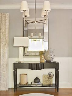 Entry Way. i like the concept. table, mirror or pictures, simple decorations...