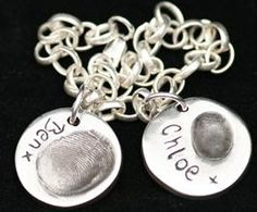 My husband wears one of these with my stepsons thumb print & name. We made it for him for Fathers Day.  metal clay thumbprint with names