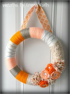 wreaths yarn, yarn wreath ideas, fabric flowers, color combos, color pallettes, orange party, housewarming gifts, parti, yarn wreaths